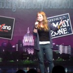female stand-up comedian Christina Irene onstage at a comedy club